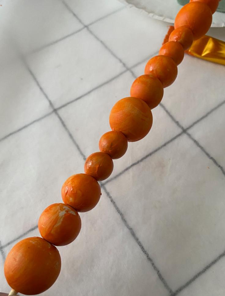 orange beads on skewar