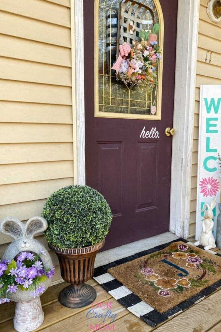 spring front porch with welcome sign