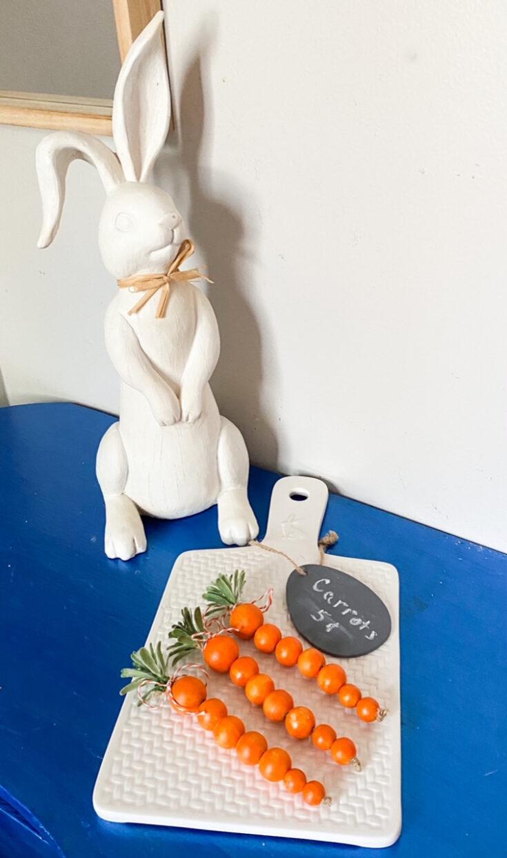 orange painted wood bead carrots on table