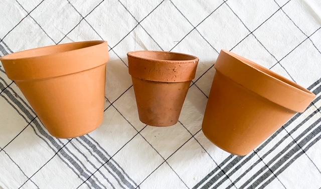 3 terracotta pots