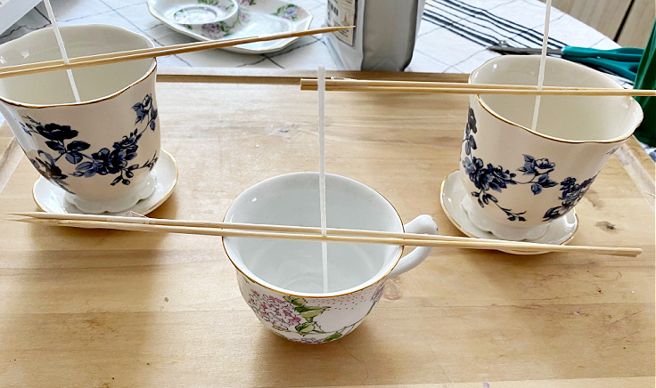 bamboo skewers and candle wicks on teacups