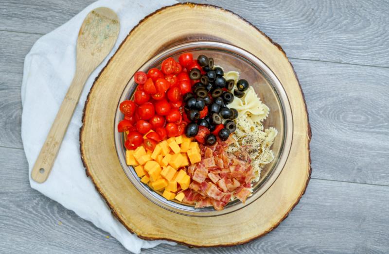 Bacon Cheddar Ranch Pasta Salad mixed in bowl