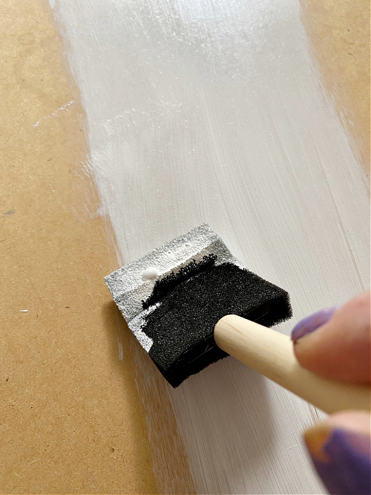 painting thrift store table with foam brus