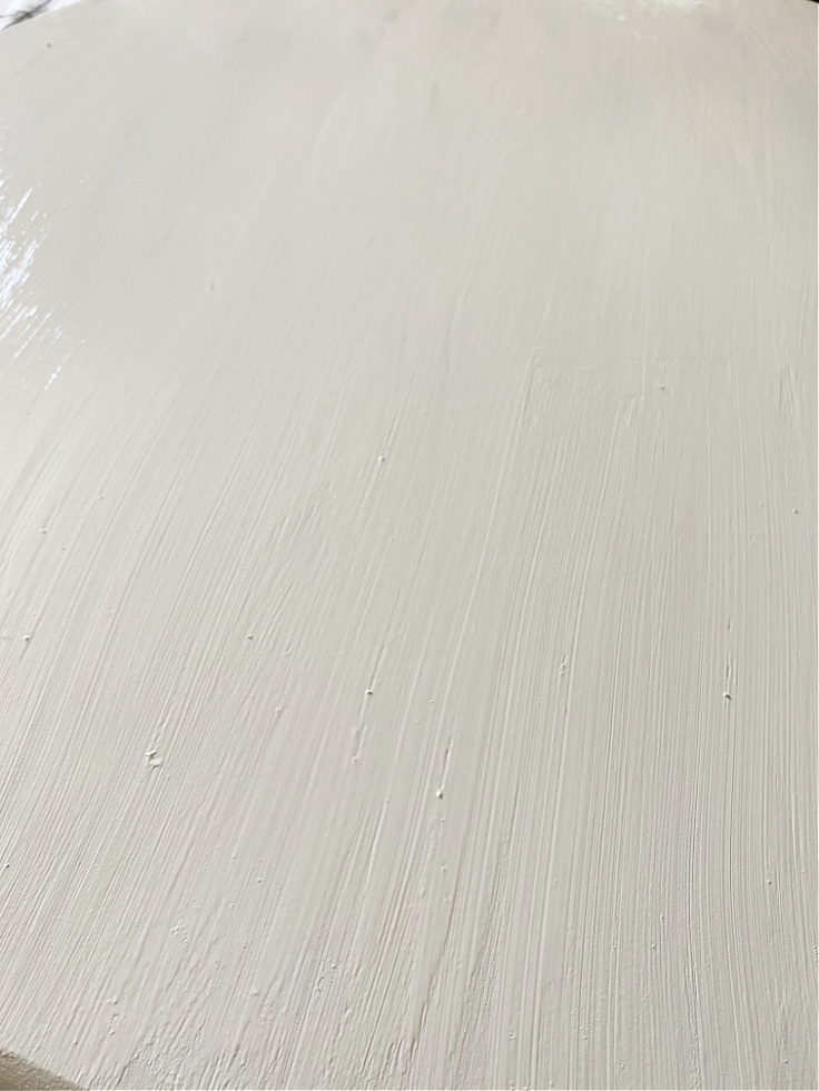close up of white painted round table