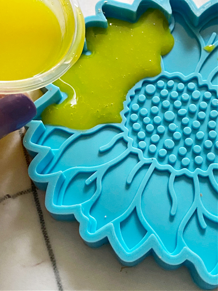 pouring resin into sunflower mold