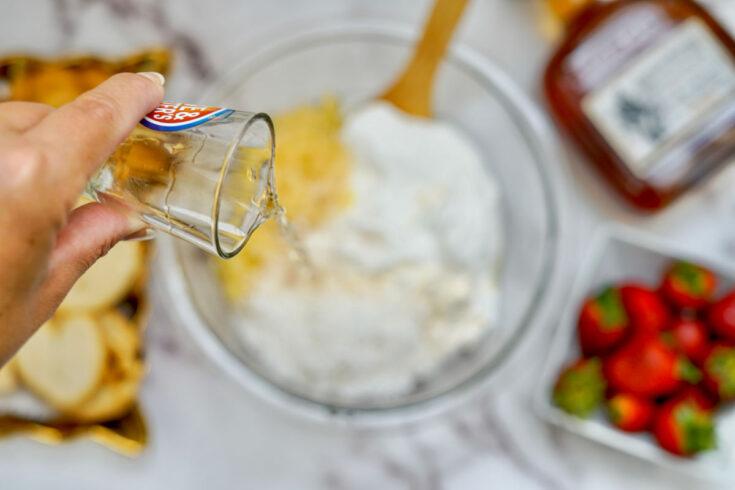pouring rum in pina colada dip