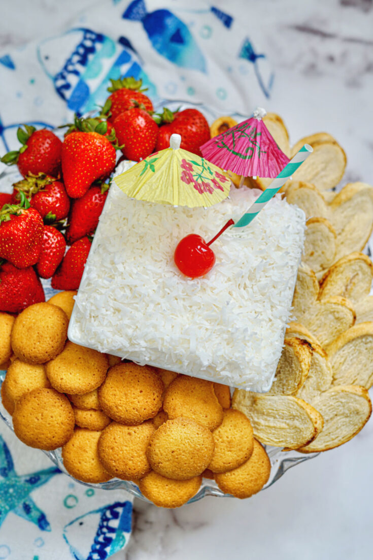 Pina Colada Dip on counter with cookies and fruit
