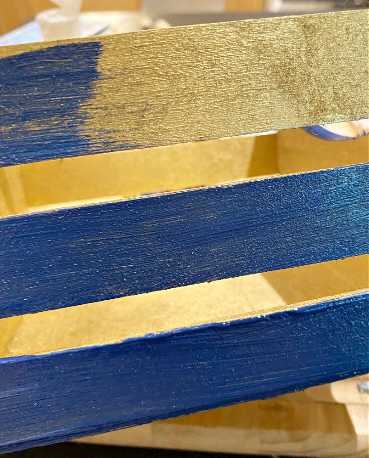 painting crate with navy paint