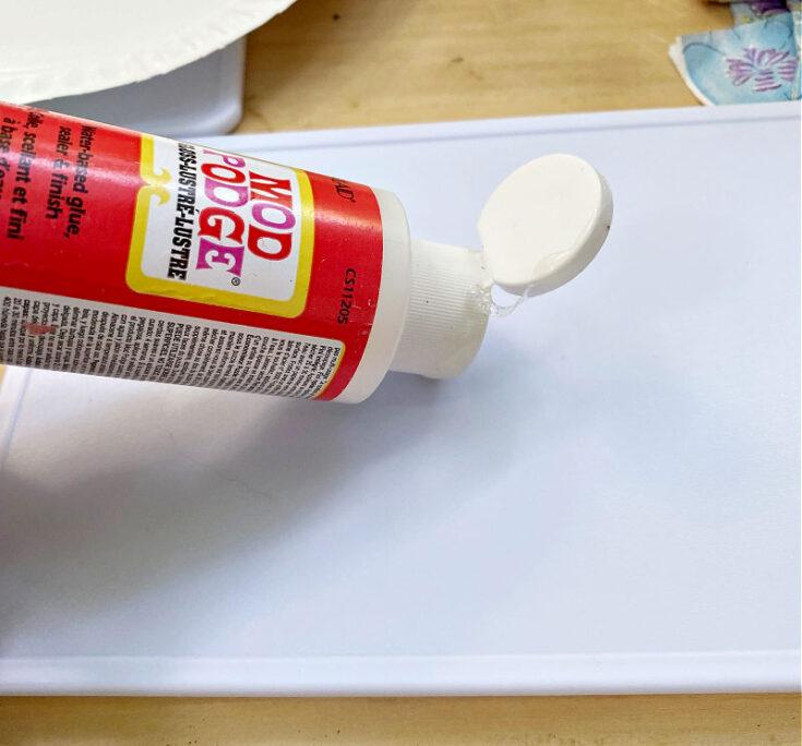 putting mod podge on cutting board