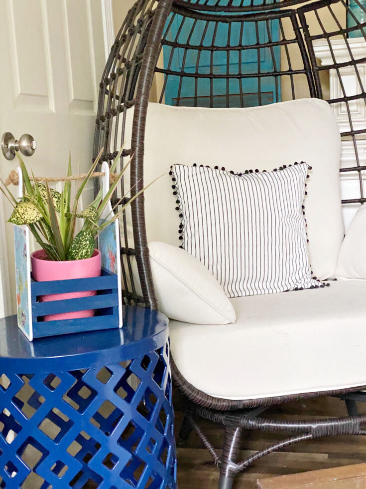 DIY Dollar Tree Cutting Board Craft as plant holder next to egg chair