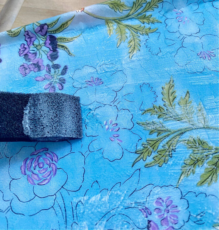 placing top coat of mod podge on napkins