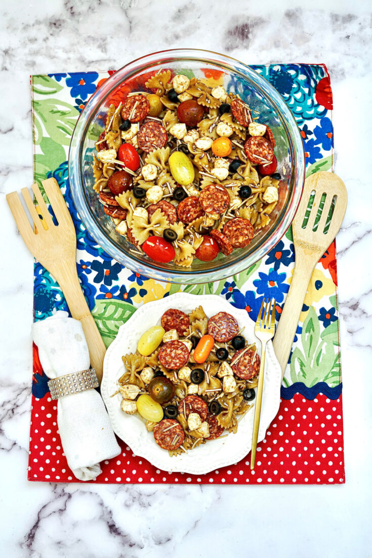 Balsamic Pasta Salad served in large bowl with serving plates