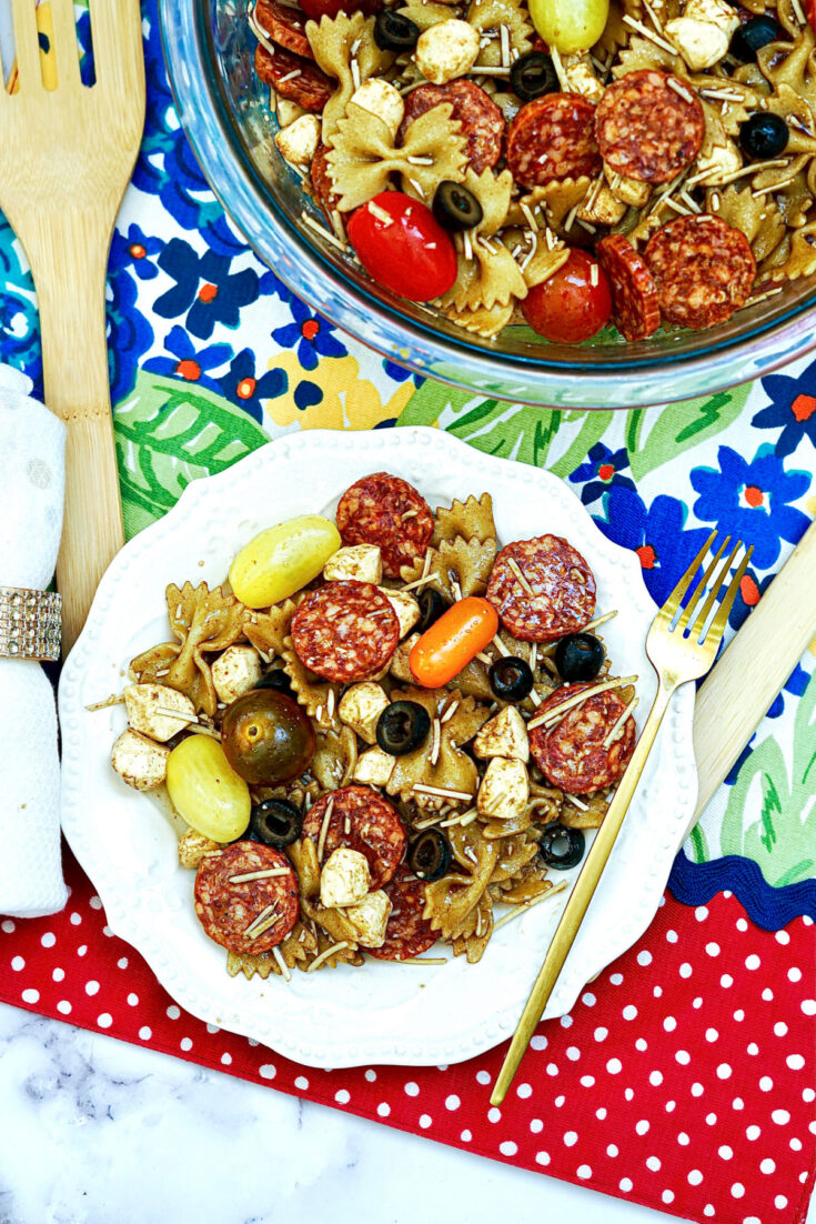 Balsamic Pasta Salad in serving bowl with plates