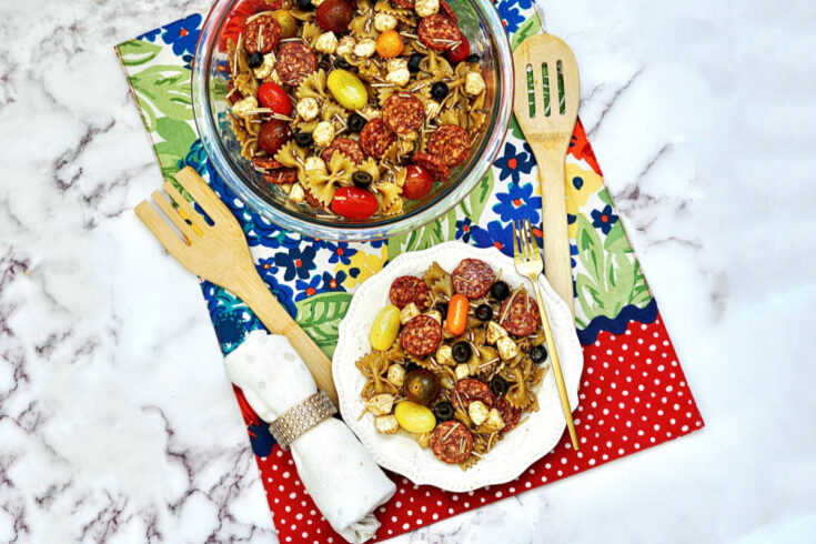 Balsamic Pasta Salad shown on counter with floral placemat
